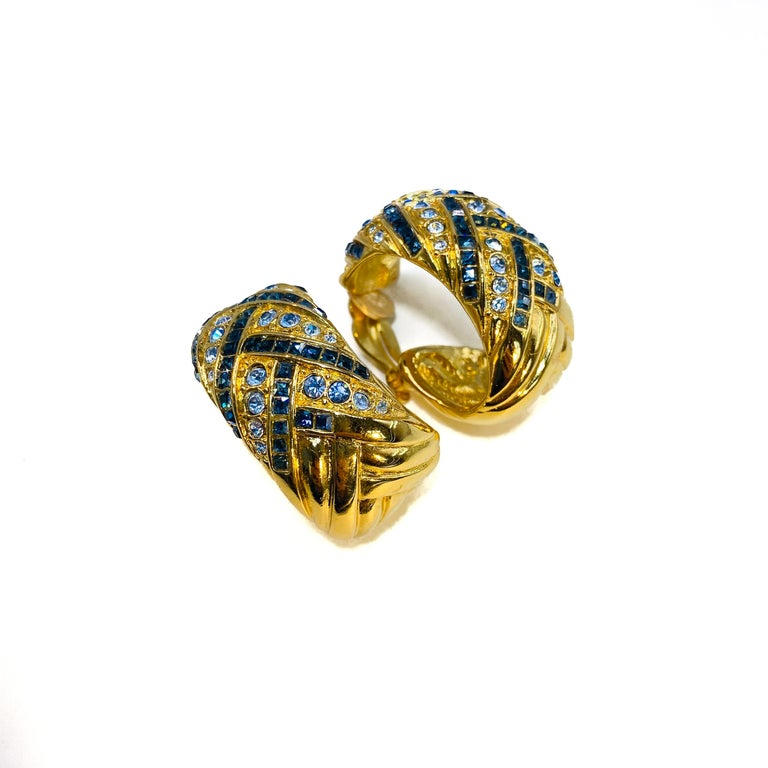 YSL Vintage 1980s Clip On Earrings  Show stopping statement earrings from the Yves Saint Laurent 80s archive  Detail -Cast from gold plated metal and set with tiny Aegean and baby blue crystals -Made in France in the 1980s -Large half hoop