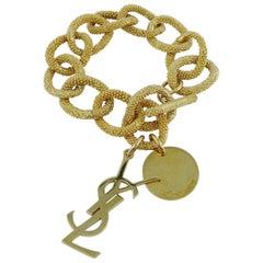 Yves Saint Laurent YSL Gold Toned Chain Logo Charm Bracelet