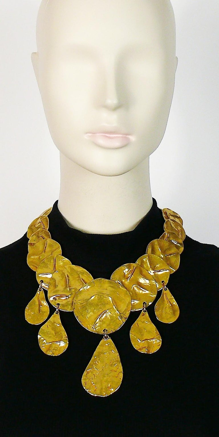 YVES SAINT LAURENT vintage rare opulent gold toned articulated necklace featuring crumpled disc links and drops with central drop engraved YVES SAINT LAURENT.  Adjustable lobster spring closure.  Embossed YSL Made in France on the clasp.  Indicative