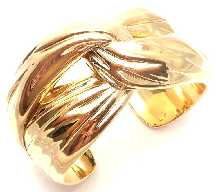18k Solid Yellow Gold Cuff Bangle Bracelet by Yves Saint Laurent YSL Paris.  Details:  Length: 7.5 inches Width: 1