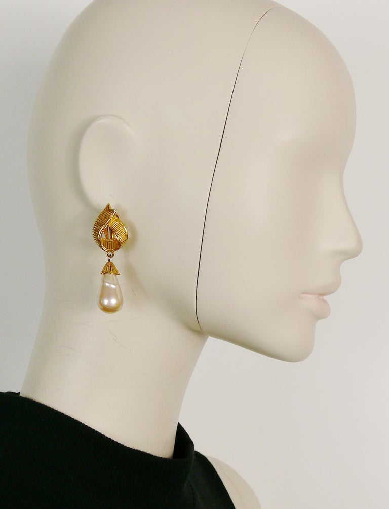 YVES SAINT LAURENT vintage gold toned ribbed textured ribbon design dangling earrings (clip-on) geaturing a large faux pearl drop.  Marked YSL. Made in France.  Indicative measurements : height approx. 5.6 cm (2.20 inches) / max. width approx. 1.9