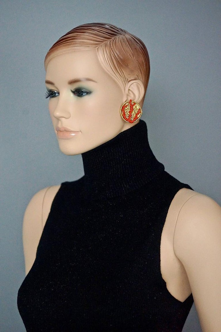 Vintage YVES SAINT LAURENT Ysl by Robert Goossens Coral Branch Overlay Disc Medallion Earrings  Measurements: Height: 1.45 inches (3.7 cms) Width: 1.37 inches (3.5 cm) Weight per Earring: 18 grams  Features: - 100% Authentic YVES SAINT LAURENT by