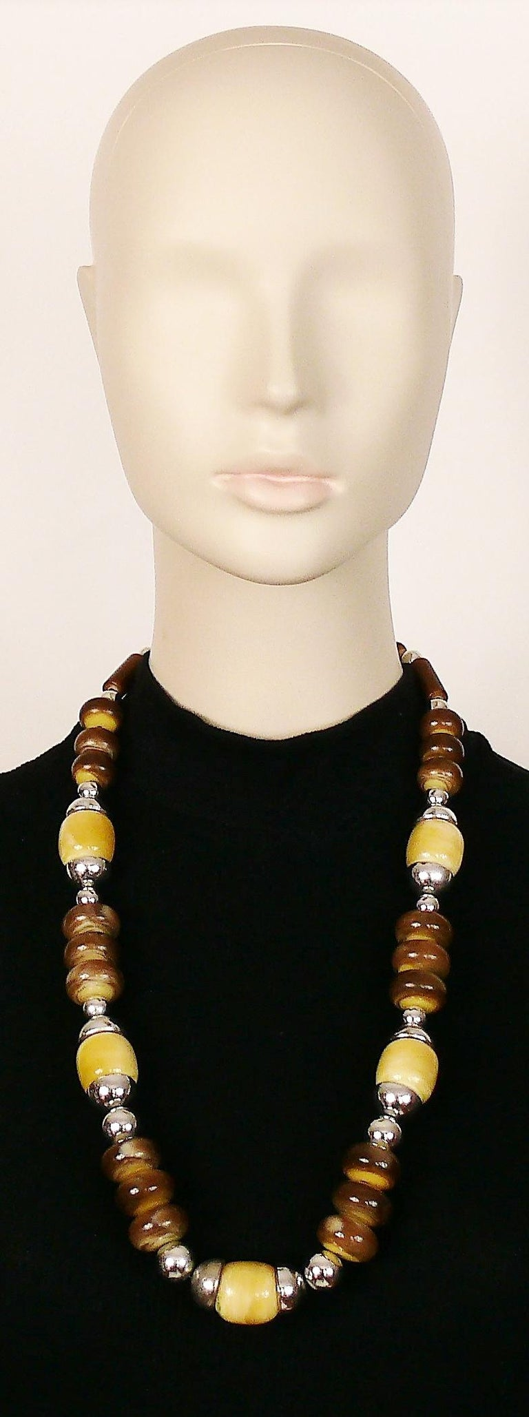 YVES SAINT LAURENT vintage 1970s necklace featuring faux horn and faux ivory graduated resin beads with sivler toned elements.  Embossed YSL on a metal tag.  Indicative measurements : length worn approx. 33 cm (12.99 inches).  JEWELRY CONDITION