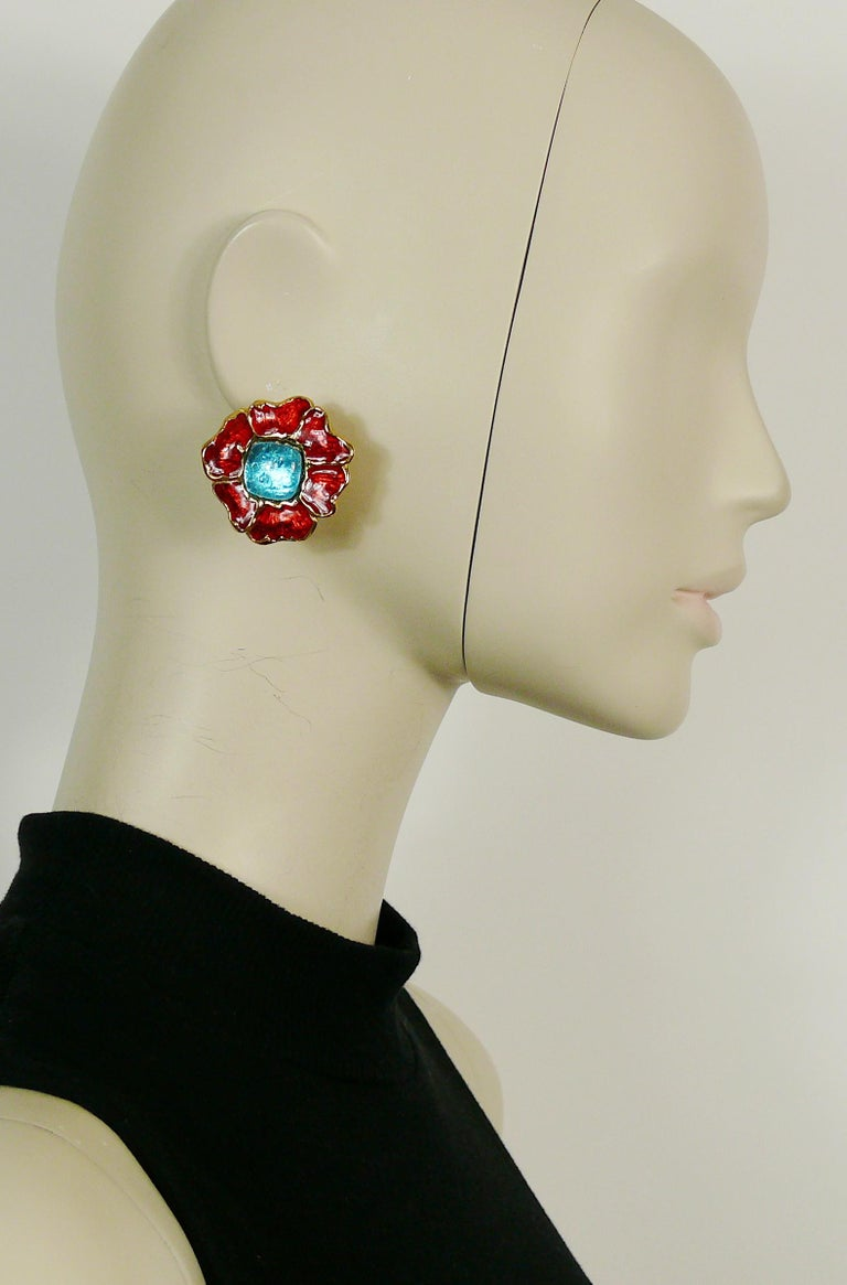 YVES SAINT LAURENT vintage gold toned floral clip-on earrings embellished with red enamel and acqua blue glass cabochon center.  Embossed YSL Made in France.  Indicative measurements : max. 3.7 cm x max. 3.5 cm (1.46 inches x 1.38 inches).  NOTES -