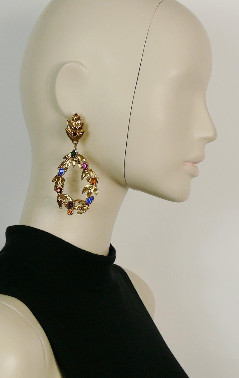 YVES SAINT LAURENT vintage gold toned dangling earrings (clip-on) featuring laurel with multi colored crystal embellishement.  Marked YSL Made in France.  Indicative measurements : height approx. 9.2 cm (3.62 inches) / max. width approx. 4.2 cm