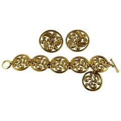 Yves Saint Laurent YSL Vintage Gold Toned Scrolls Bracelet and Earrings Set