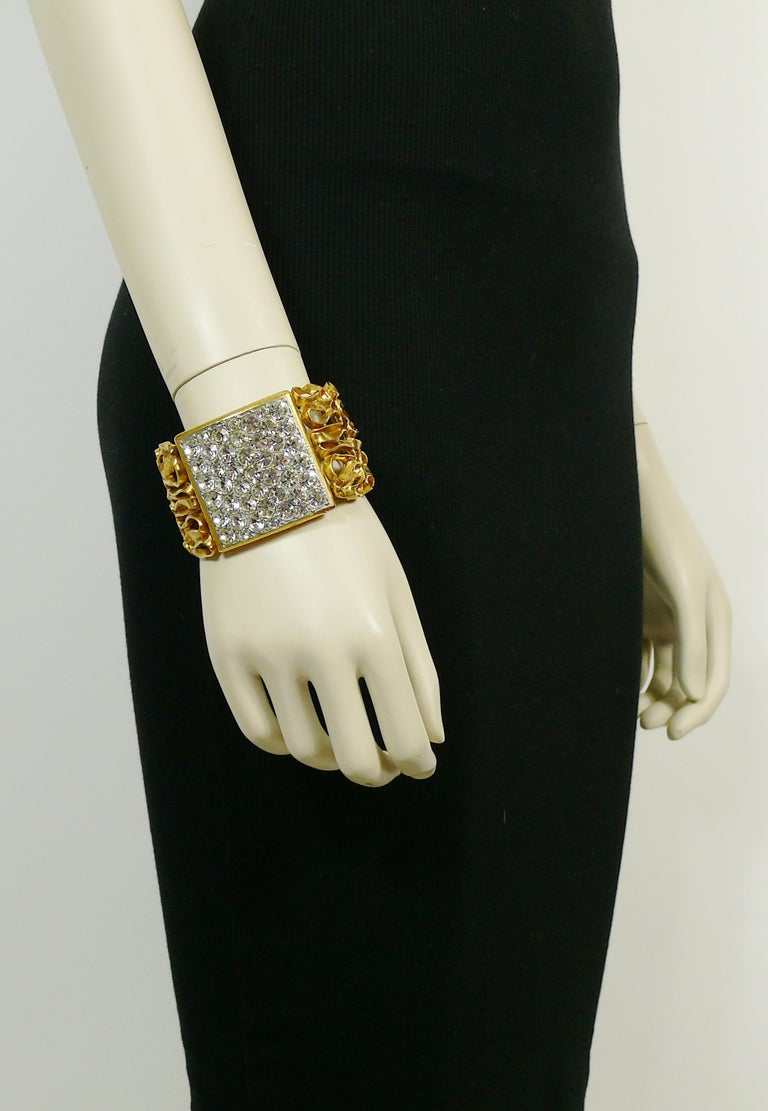 YVES SAINT LAURENT vintage rare gold toned cuff bracelet featuring a coiled wire pattern and a large square section embellished with clear crystals.  Embossed YVES SAINT LAURENT RIVE GAUCHE Made in France.  Indicative measurements : inner
