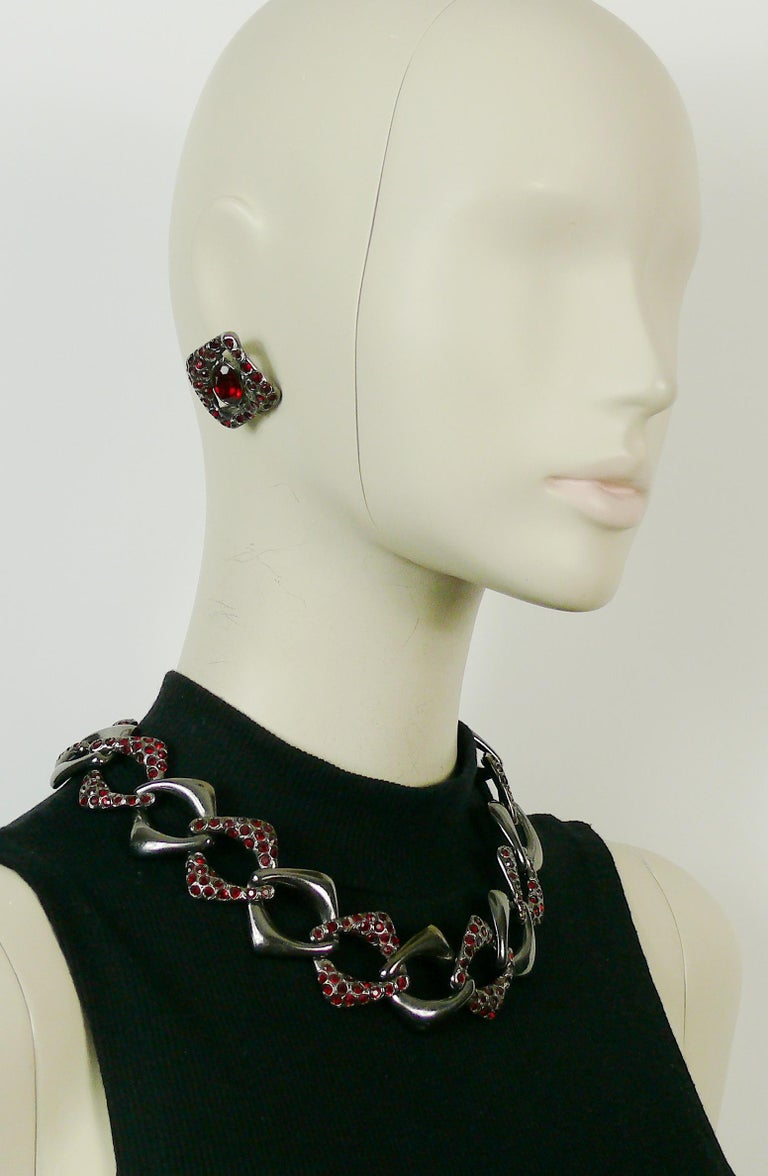 YVES SAINT LAURENT vintage gun patina chain link necklace and clip-on earring set embellished with ruby crystals.  Embossed YSL Made in France.  NECKLACE indicative measurements : adjustable length from approx. 43 cm (16.93 inches) to approx. 48 cm