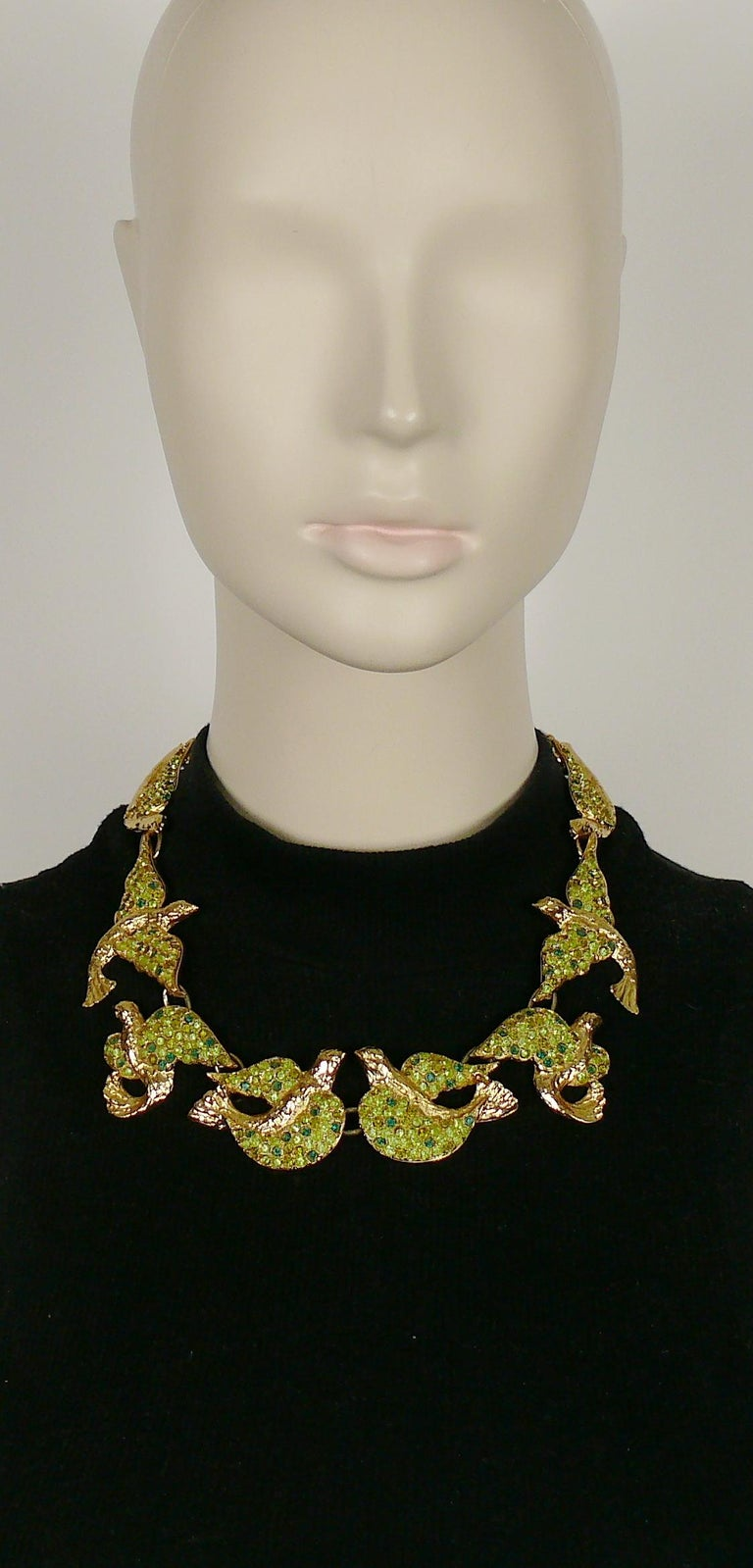 YVES SAINT LAURENT vintage rare gold toned necklace featuring bird links embellished with green shade crystals.  Lobster clasp closure. Adjustable length.  Embossed YSL Made in France.  Indicative measurements : adjustable length from approx. 43 cm