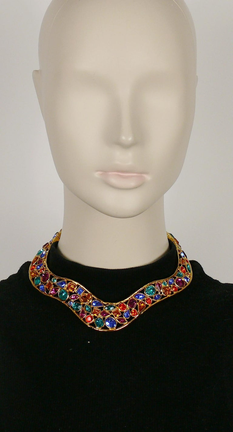 YVES SAINT LAURENT vintage openwork gold toned choker necklace embellished with multicolored crystals.  Marked YSL Made in France.  Indicative measurements : neck opening approx. 10.6 cm (4.17 inches) / max. width approx. 2.6 cm (1.02