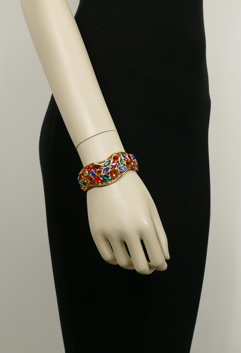 YVES SAINT LAURENT vintage openwork gold toned cuff bracelet embellished with multicolored crystals.  Marked YSL Made in France.  Indicative measurements : inner measurements approx. 6 cm x 5.3 cm (2.36 inches x 2.09 inches) / max. width approx. 2.5