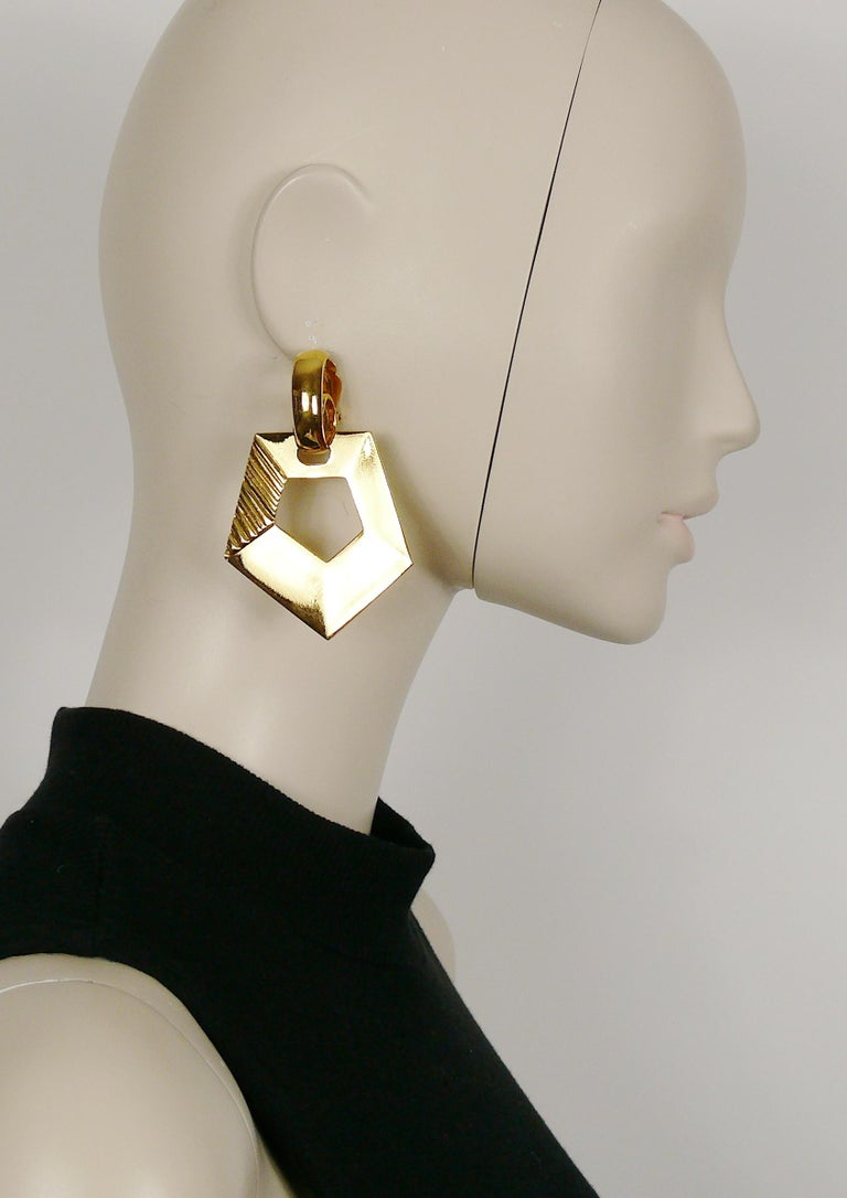 YVES SAINT LAURENT vintage massive gold toned dangling earrings (clip-on) featuring a geometric design.  Embossed YSL Made in France.  Indicative measurements : height approx. 7.5 cm (2.95 inches) / max. width approx. 5.1 cm (2.01 inches).  Comes
