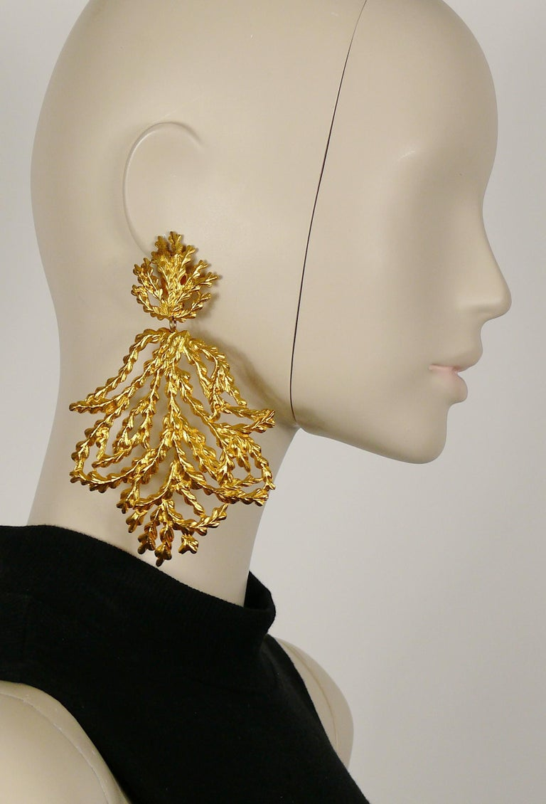 YVES SAINT LAURENT Rive Gauche vintage oversized dangling earrings (clip-on) featuring an opoluent openwork foliage design.  Embossed YVES SAINT LAURENT Rive Gauche Made in France.  Indicative measurements : max. height approx. 12.7 cm (5 inches) /