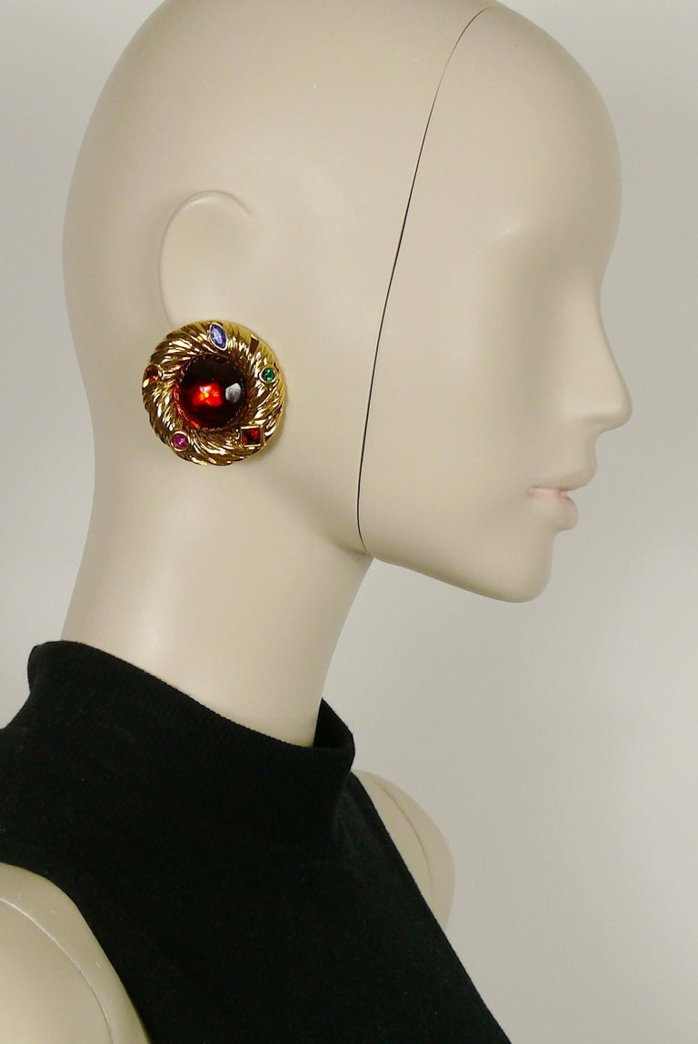 YVES SAINT LAURENT vintage gold toned nest design clip-on earrings featuring a large red resin cabochon center and multicolored crystals.  Embossed YSL Made in France.  Indicative measurements : diameter approx. 4.5 cm (1.77 inches).  NOTES - This