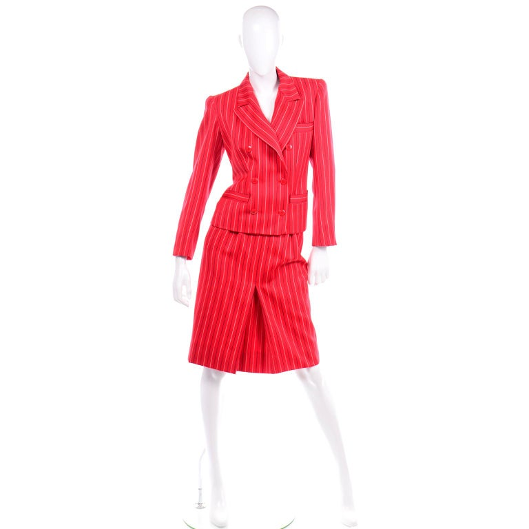 This incredible vintage red 2 piece skirt suit from Yves Saint Laurent is in excellent condition and was most likely never worn!  The lovely red fine wool fabric has Navy and white pinstripes.  The blazer / jacket is double breasted with shoulder