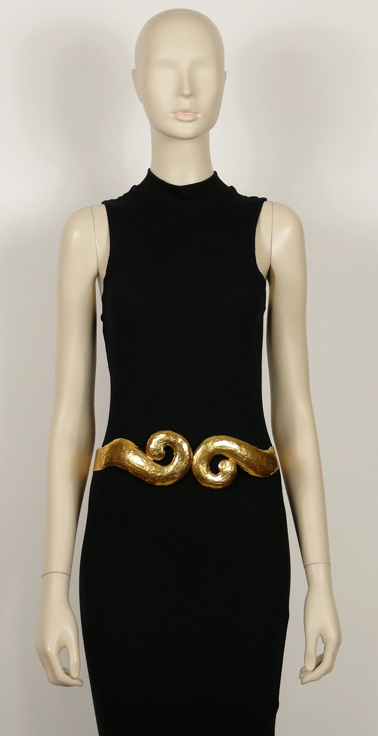 YVES SAINT LAURENT vintage rigid gold toned hammered metal belt featuring swirl pattern at the front.  Hook closure.  Embossed YVES SAINT LAURENT RIVE GAUCHE Made in France.  Indicative measurements : inner max. measurements approx. 27 cm x 21 cm