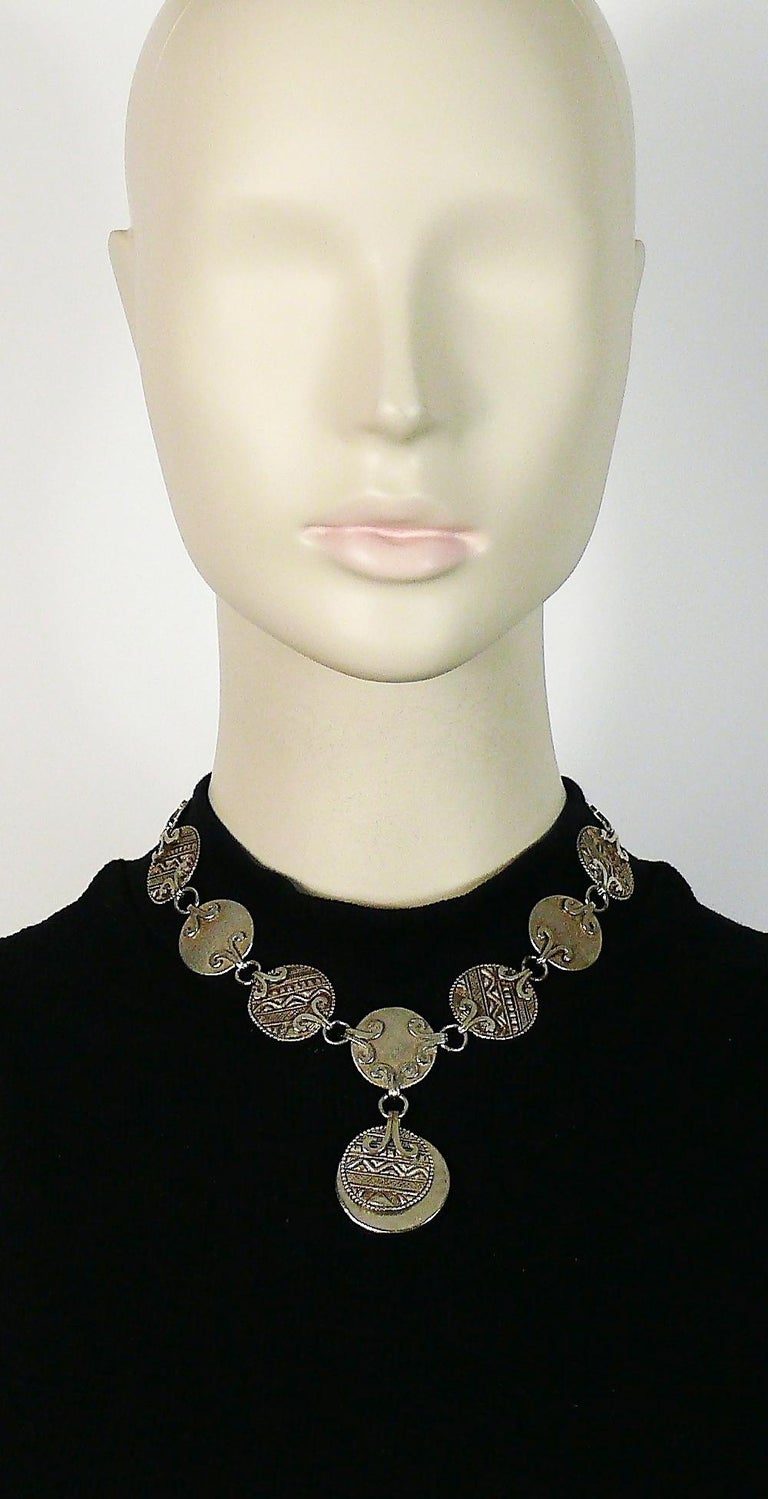 YVES SAINT LAURENT vintage antiqued silver tone disc links necklace featuring tuareg pattern inspired engravings.  Adjustable T-bar and toggle closure.  Embossed YSL Made in France.  Indicative measurements : adjustable length from approx 37 cm