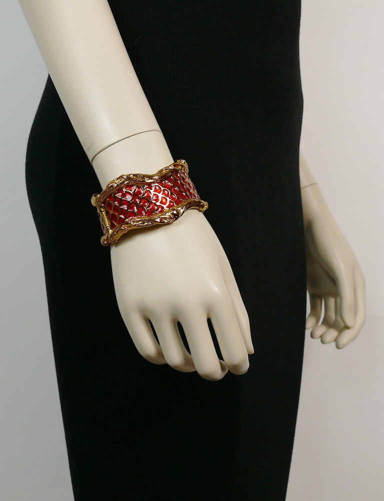 YVES SAINT LAURENT vintage gold toned bracelet featuring coiled snakes/serpents embellished with red enamel.  Embossed YSL Made in France.  Indicative measurements : inner measurements approx. 5.7 cm x 5 cm (2.24 inches x 1.97 inches) / width