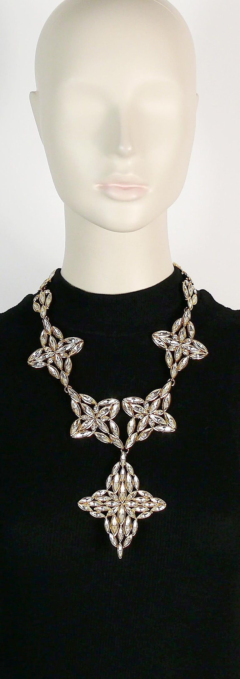 YVES SAINT LAURENT vintage gold toned statement necklace featuring stylized flowers embellished with clear crystals.  Lobster clasp closure. Adjustable length.  Embossed YSL Made in France.  Indicative measurements : adjustable length from approx.