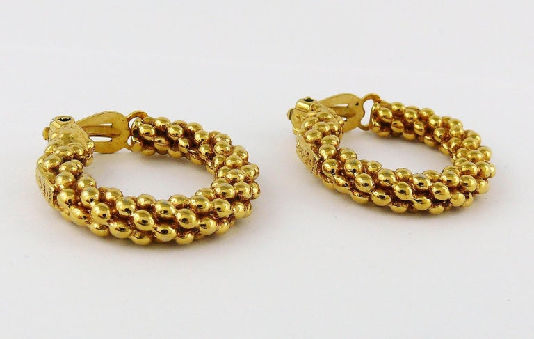 YVES SAINT LAURENT vintage gold toned textured hoop earrings (clip-on).  Embossed YSL Made in France.  Indicative measurements : diameter approx. 3 cm (1.18 inches).  JEWELRY CONDITION CHART - New or never worn : item is in pristine condition with