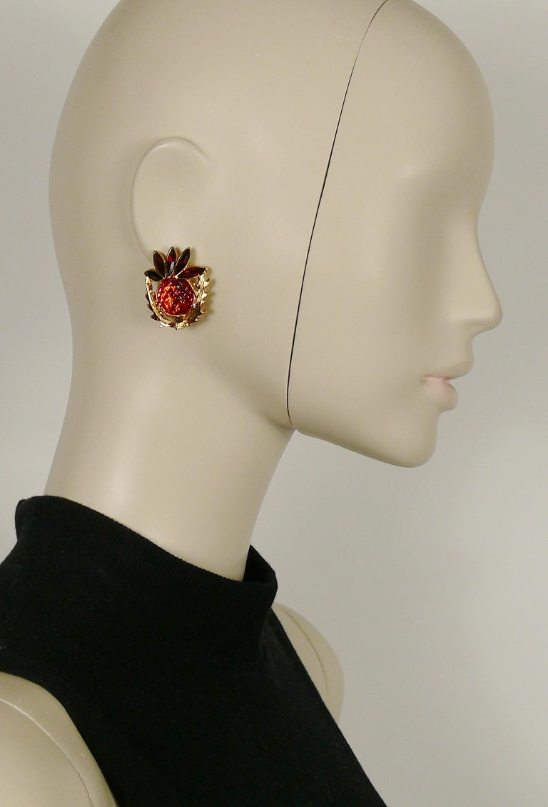 YVES SAINT LAURENT vintage textured red lucite resin thistle motif clip-on earrings embellished with crystals on top.  Embossed YVES SAINT LAURENT Rive Gauched Made in France.  Indicative measurements : approx. 3.3 cm x 2.8 cm (1.30 inches x 1.10