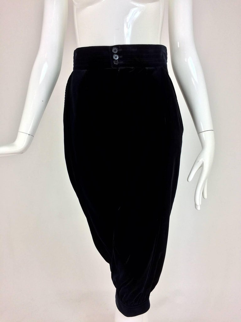 Yves St Laurent navy & black velvet knickers 1970s. Cotton velvet knee length trouser with a wide high waist band that closes with double buttons. The trousers are fitted at the back, the front has curved hip front pockets and a bit of gathering,
