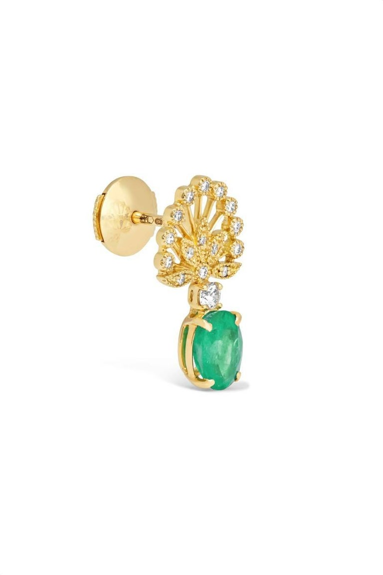 Earrings in Yellow Gold 18 carats 4,5gr Approx. Diamonds 0,30 Carats Approx. Emeralds 1,40 Carats Approx. Alpa System Sold as a pair