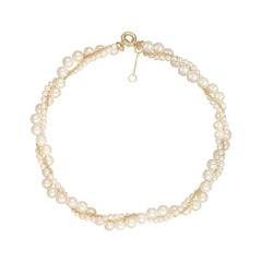 Yvonne Leon's Necklace in 18 Karat Yellow Gold Twisted Pearls and Chain