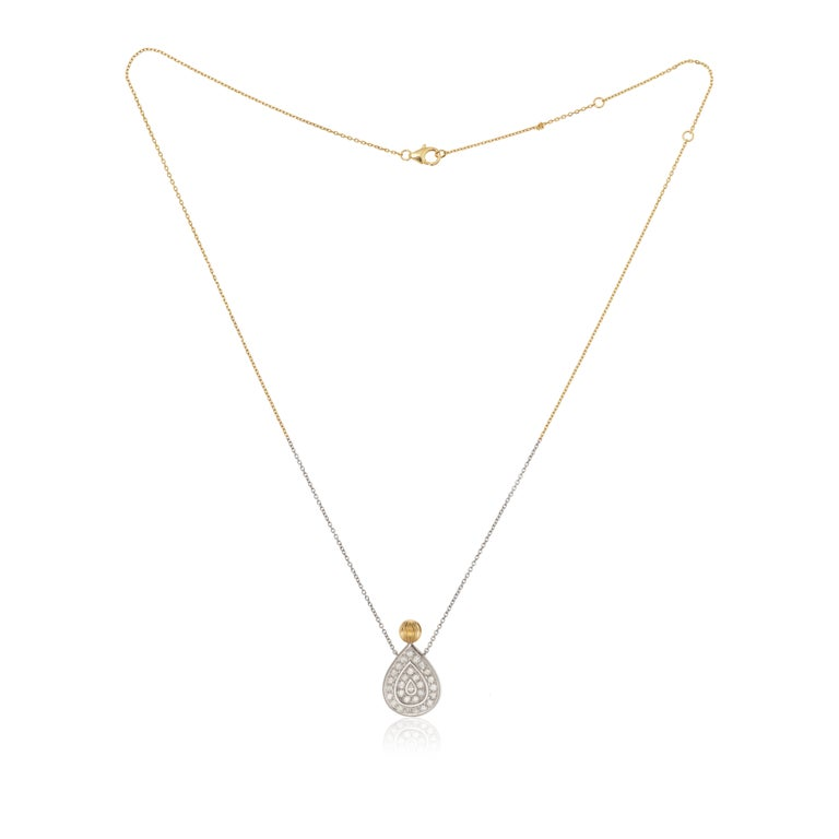Necklace in yellow and White Gold 18 carats 6,7gr approx. Grey Diamonds 0,78 carats approx. Pear Shape Diamond 0,04ct approx. Totale Length : 40cm / 45cm / 50cm Chain detail is yellow gold on the top and white gold on the below.