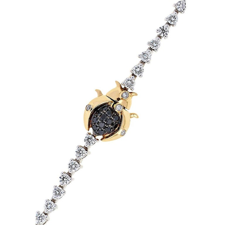 Riviere Bracelet in 18 Carats White Gold 18,3gr approx. Scarabee motive in 18 Carats Yellow Gold  Diamonds 2,30ct approx. Black Diamonds 0,009ct approx. Scarabee Motive as Closure Total Length 34cm