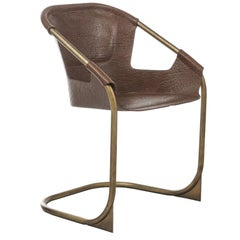 Zahir, Contemporary Dining Chair in Leather with Aged Brass Legs