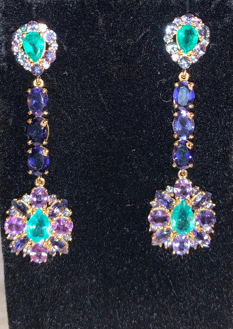Sabrina Balsky Jewelry One of a Kind Zambian Blue Green Emerald Earrings bordered with 28 2mm Alexandrites and 12 3mm Alexandrites and  Purple Sapphires, joined with Faceted Iolites set in 18kt yellow gold. Very Rare Russian Alexandrite stones