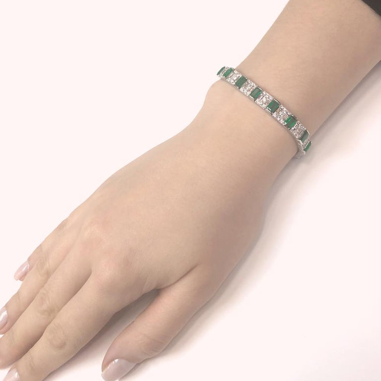 Retro inspired handcrafted platinum 950 bracelet with emerald cut emeralds 14.9 ct stones from Zambia.  Accented with white round diamonds 13.39 ct. Diamonds are natural in G-H Color Clarity VS.  This is a gorgeous emerald and diamond platinum