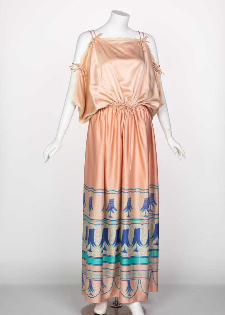 Zandra Rhodes' designs verge on the ethereal and the eclectic. Her loosely fitting caftan style dresses in the 1970s paid homage to a more international aesthetic while adding in her own element of play to the designs, particularly through the