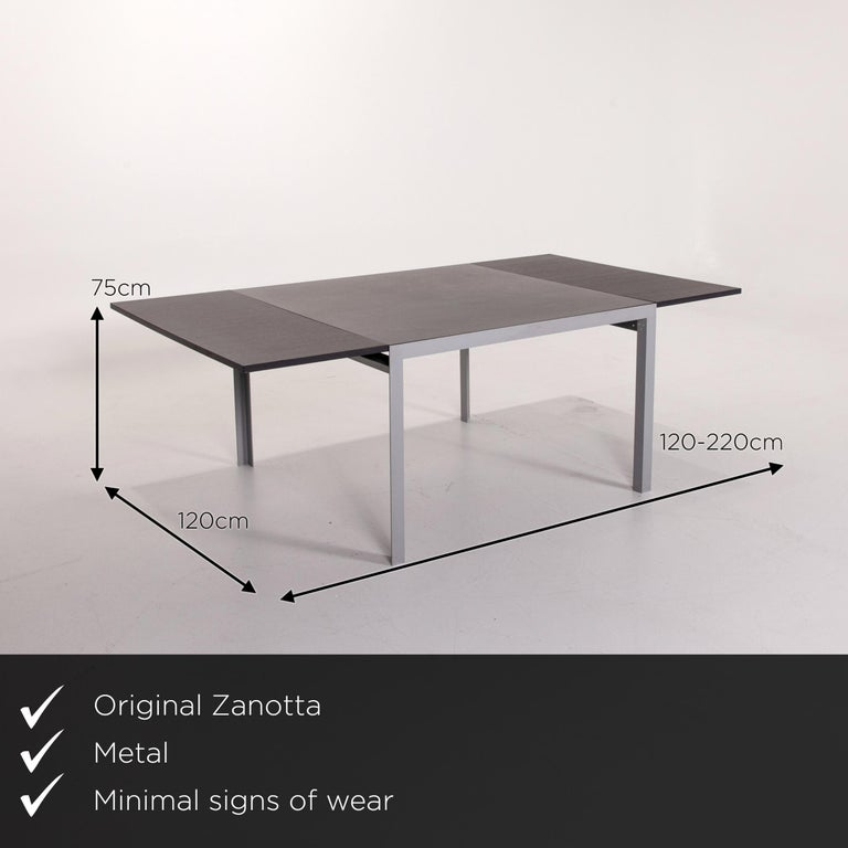 We present to you a Zanotta Estenso metal dining table wood brown folding table function.      Product measurements in centimeters:    Depth 120 Width 120 Height 75.