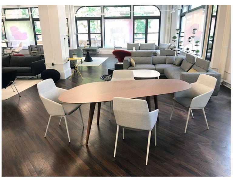 Tweed 217 Measure: 217 x 100 walnut Table. Top in natural painted Canaletto walnut veneered wood, with black painted under-top. Smoothly irregular shape. Not just a simple exercise of scale but different models to allow gathering together or a
