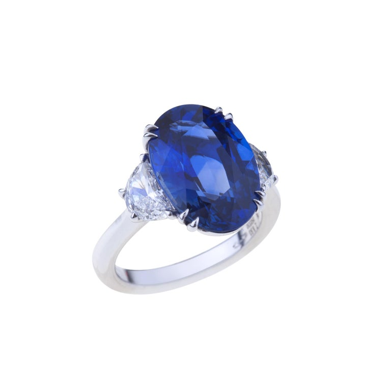Sapphire Ring White Gold with Diamonds, with Certificate. Contemporary design for this Ring with a Stunning Blue Oval Sapphire (ct. 8.93 Certificate GRS ) with two Side Diamonds (ct. 1.06) for this Unique Piece. Wholly Manufactured in Italy.