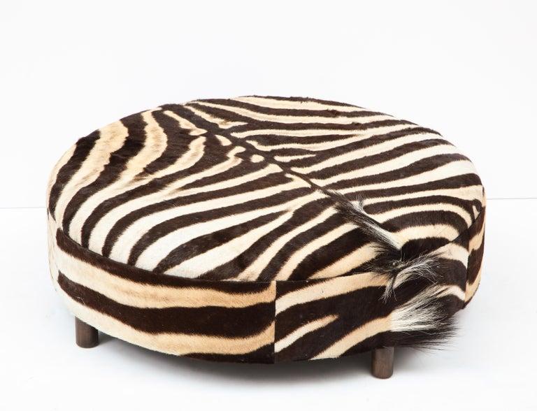 Zebra Hide Ottoman, Chocolate & Cream, Round, Contemporary, In Stock, New Hides In New Condition For Sale In New York, NY
