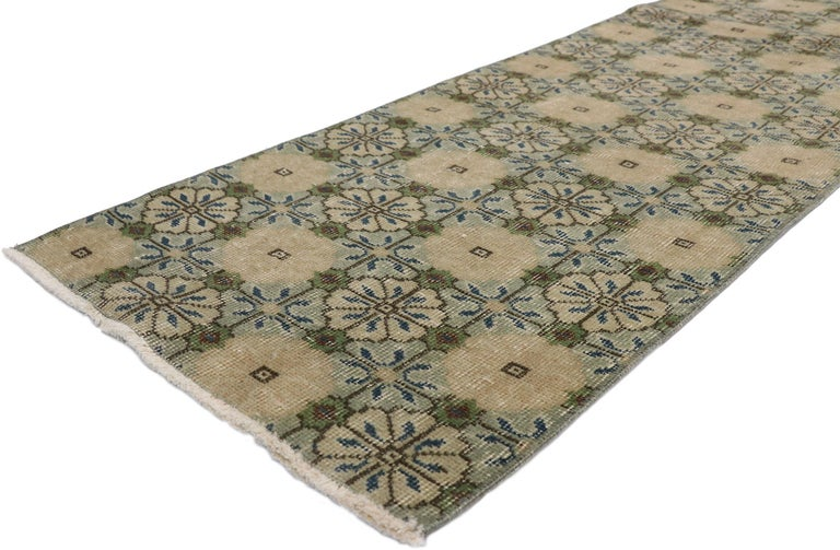 52613, Zeki Muren distressed vintage Turkish Sivas Runner with Swedish Farmhouse style. Lovingly timeworn with Gustavian grace, this hand knotted wool distressed Turkish Sivas runner beautifully embodies a Swedish Farmhouse style. The field is