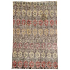 Zeki Muren, Distressed Vintage Turkish Sivas Rug with Industrial Art Deco Style