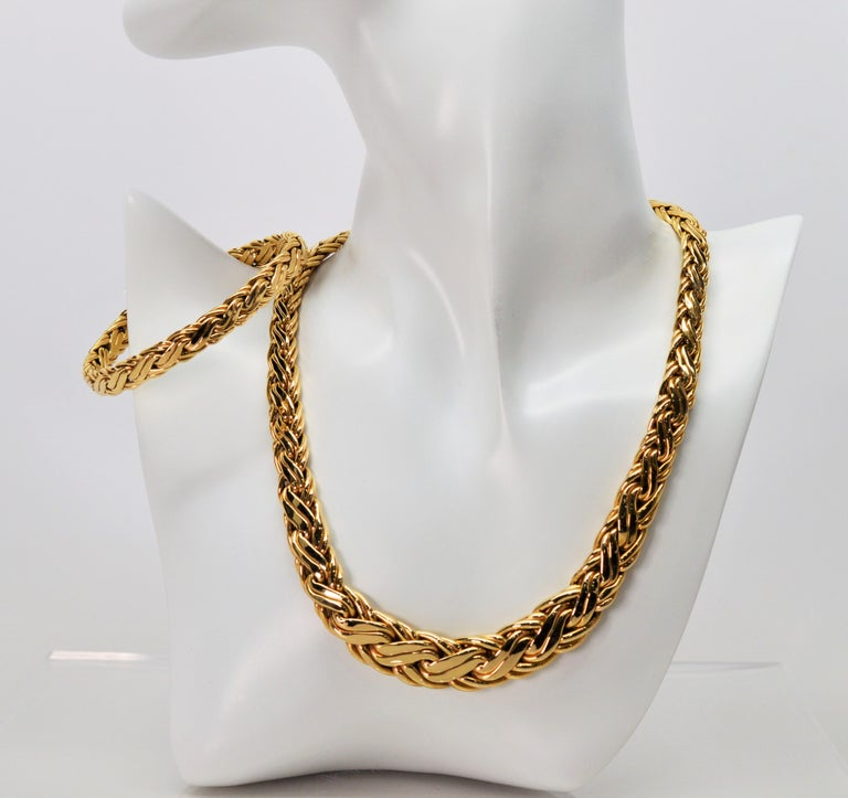 Fabulous matching necklace and bracelet set from Zelman & Friedman (Z&F) Jewelers. Both pieces are of a double braided thick fourteen carat 14K gold and stamped and signed the New York City maker. The graduated collar necklace measures 16 inches and