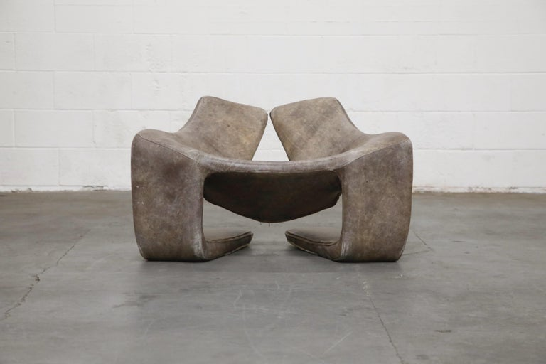 This beautifully patinated leather chair is called the 'Zen' chair, designed by Kwok Hoi Chan for Steiner in Paris, France, in the 1970s. This low lounge chair, completely wrapped in a removable leather cover, is gorgeous with deeply patinated