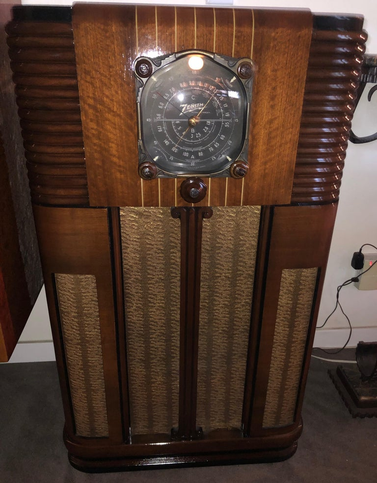 This is an uncommon and super playing Zenith ten-tube console radio, ready for you to proudly display and listen to. The sculpted ribs on the sides are an outstanding feature, and the design was patented. From the Golden Age of Radio.
