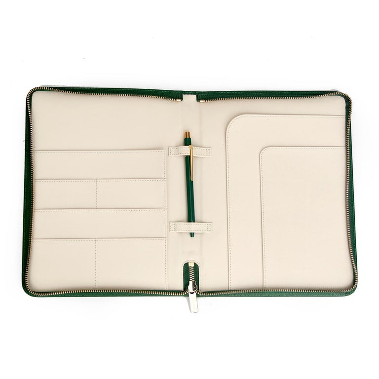 Rolex Leather Portfolio with Caran D'ache Pen  - Green leather zip-around Rolex portfolio with creme interior, gold-tone hardware, 8 pockets, pen loops and Caran d'Ache for Rolex ballpoint pen. Height: 10