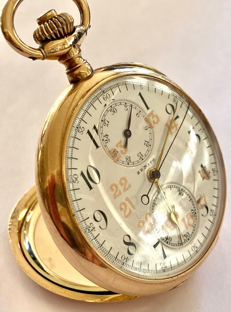 One (1) 14K. Yellow gold pocket watch brand: Zenith Function: time, second hand and 30 minute chronograph size: diameter: 50 mm. thickness: 13 mm Weight: 83.21 grams Case no : 186431 movement no: 2358914 Made around 1930 Comes with the original box