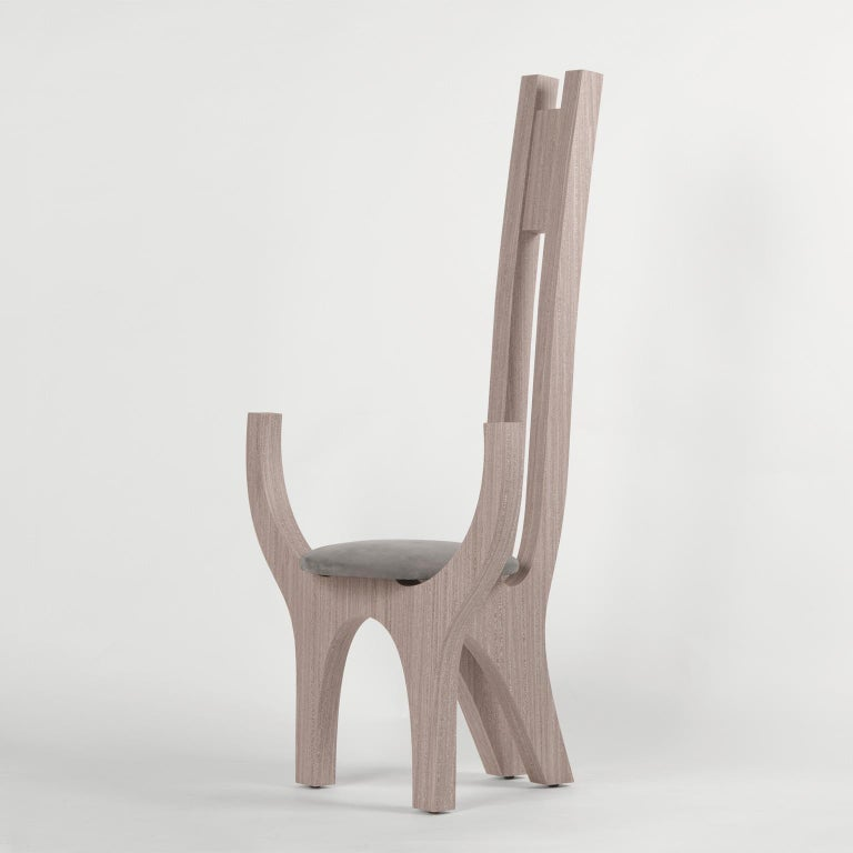 Big sculpture chair with armrests, made of wood covered by hand with a natural wood veneer and with soft seat upholstered in nubuck leather.  Limited edition of 15 signed and numbered pieces.