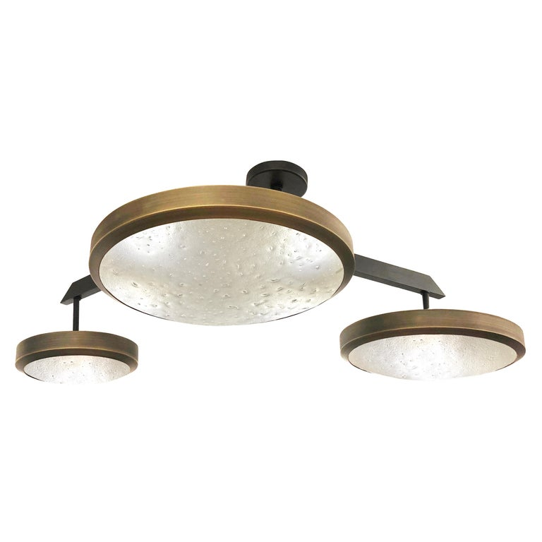 """The Zeta ceiling by form A light features a composition of variable sized Murano glass shades methodically balanced on a """"V"""" shaped brass frame. Shown in a two tone finish with the shades in bronzo ottone and the frame in brunito"""