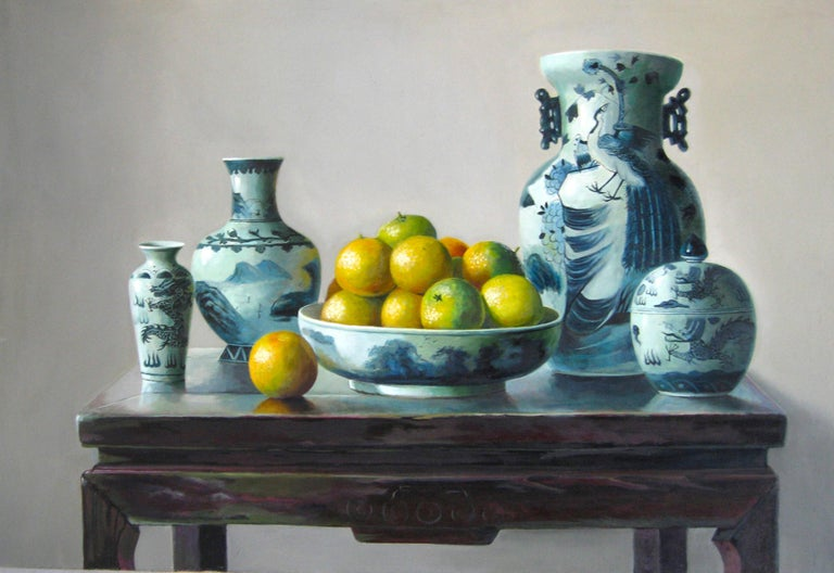 Oranges is an original oil on canvas realized by the chinese painter Zhang Wei Guang (Mirror) in 19998. Excellent conditions.  Zhang Wei Guang, also called 'mirror' was born in Helong Jang, China in 1968. He studied at the Haierbin Teacher