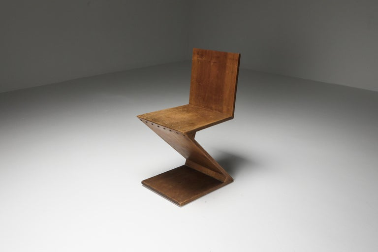 Zig-Zag chair, design 1932, executed c. 1939-1947, Produced by G. van de Groenekan or Metz & Co, NL Solid Mahogany Wood  This chair is one of the earliest fully documented zig zag chairs by Rietveld,  full provenance and expertise
