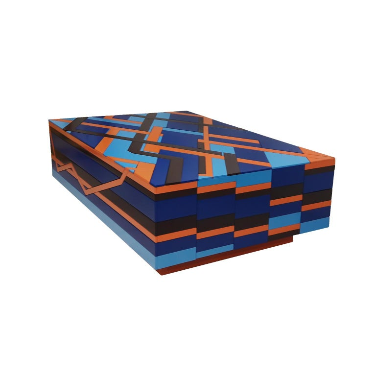 The Ziggy coffee table created by the designer Leo Di Caprio was conceived after a study of the jewels of Brazilian indigenous people, that has been working with natural seed to create geometric shape designs and combinations of colors on bracelets,